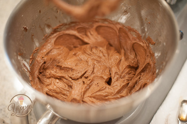 Mixing chocolate and cream cheese