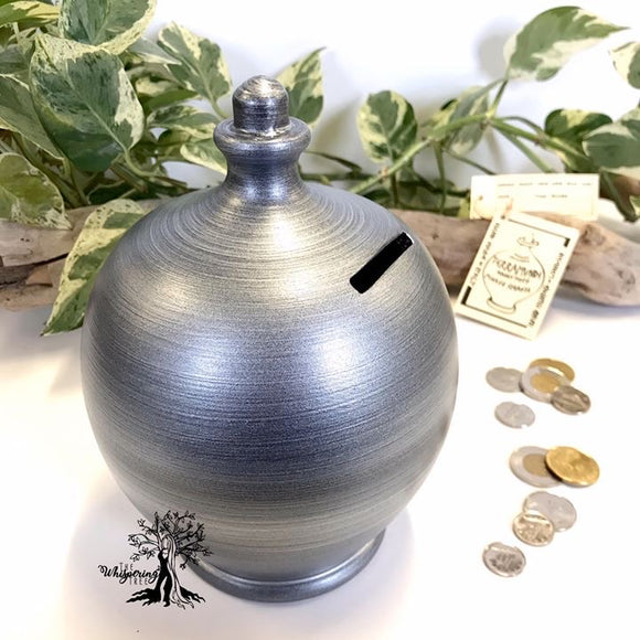 Terramundi Money Pot - Metallic Silver - Shop The Whispering Tree Inc - Grande Prairie, AB Canada. Make a wish! Fill it up! Smash the Pot! Handcrafted in Italy. Hand painted in Italy. Adult Piggybank! Money saver! Great gift idea for all occasions. Large selection of Terramundi Money Pots available.