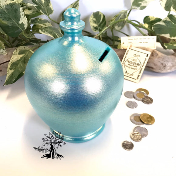 Terramundi Money Pot - Twinkle Twinkle Aqua - Shop The Whispering Tree Inc - Grande Prairie, AB Canada. Make a wish! Fill it up! Smash the Pot! Handcrafted in Italy. Hand painted in Italy. Adult Piggybank! Money saver! Great gift idea for all occasions. Large selection of Terramundi Money Pots available.