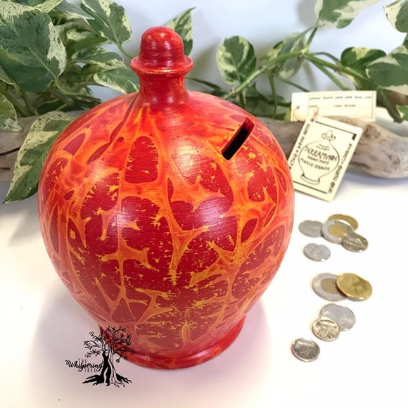 Terramundi Money Pot - Charmed Orange & Yellow - Shop The Whispering Tree Inc - Grande Prairie, AB Canada. Make a wish! Fill it up! Smash the Pot! Handcrafted in Italy. Hand painted in Italy. Adult Piggybank! Money saver! Great gift idea for all occasions. Large selection of Terramundi Money Pots available.