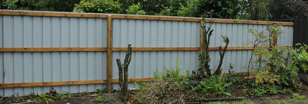 5-rib steel fence on wooden frame