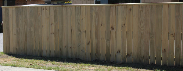 dressed board fence with cap