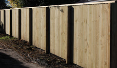 capped fence with exposed posts