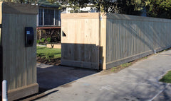 dressed board capped fence with double gates