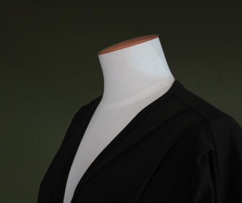 Mannequin top showing pleated shoulder details of the merino cardigan