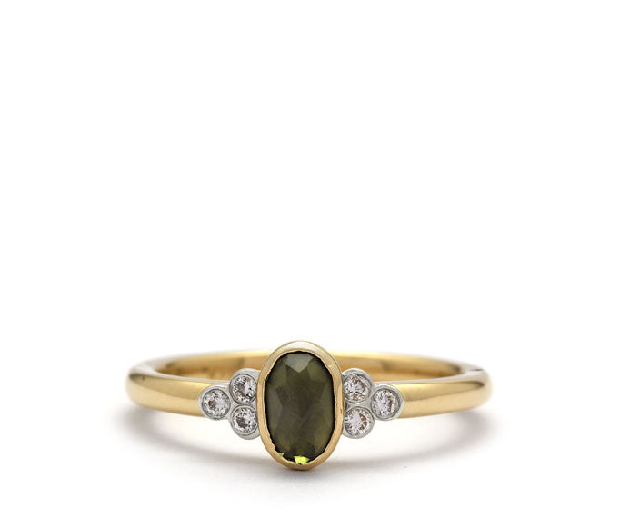 bohemian engagement ring style with diamonds and center green Tourmaline.