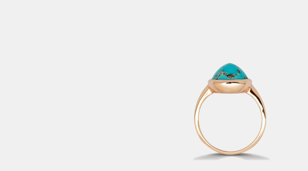 turquoise gemstone engagement ring in rose gold