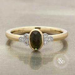 green tourmaline engagement ring