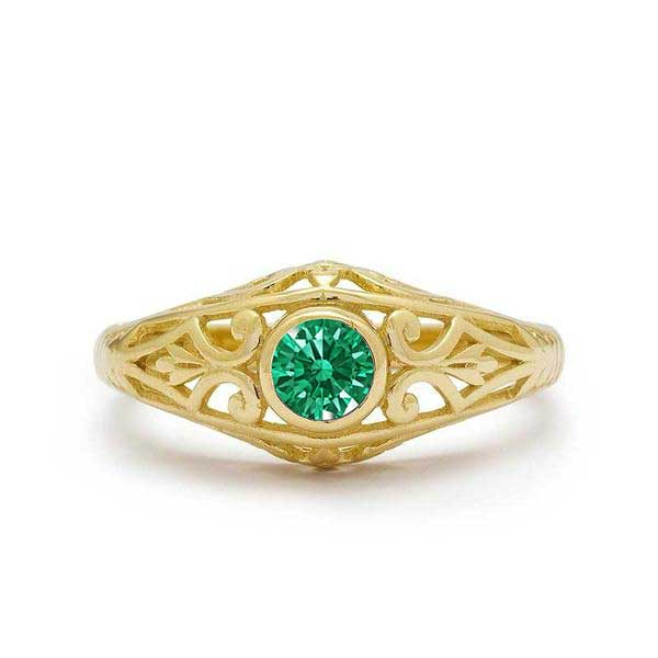 emerald engagement ring yellow gold