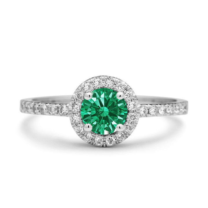 natural emerald engagement ring with diamond halo
