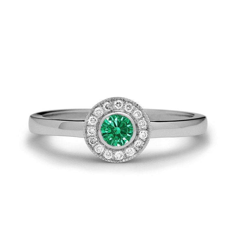 emerald engagement ring with diamonds