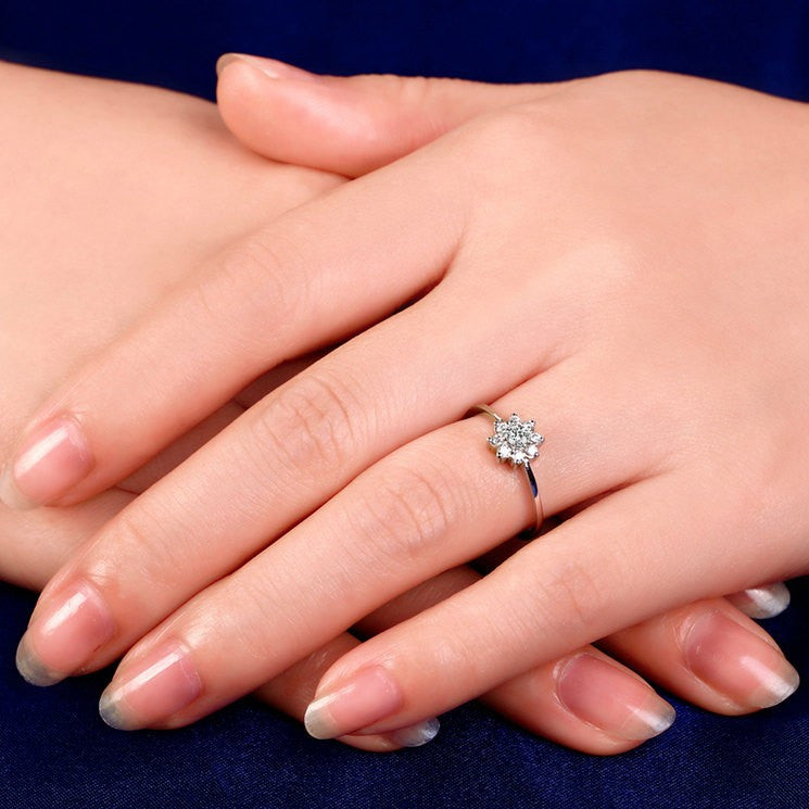 flower halo engagement ring on a hand