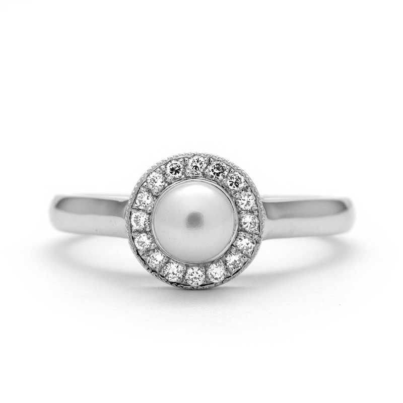 Vintage pearl engagement ring in white gold