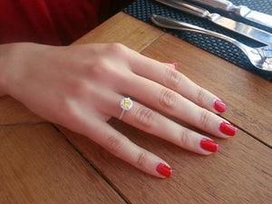 fancy yellow diamond engagement ring hand