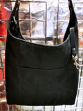 Heavy canvas tote bag with large exterior pocket and leather tether for keys.