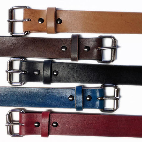 handmade leather belts available in red, blue, black or brown.