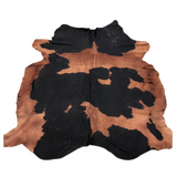 Hair on cowhide black and white dyed brown