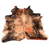 Hair on cowhide brindle acid wash dyed orange