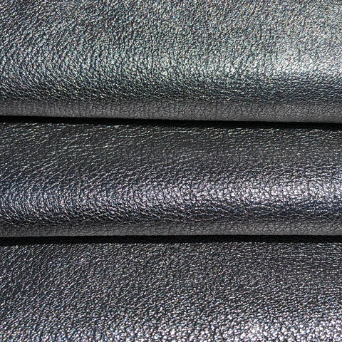 Italian sheep leather painted silver over black background