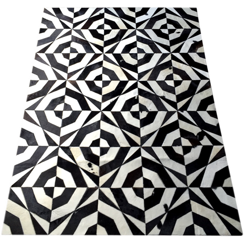 Hair on cowhide area rug - Black and white