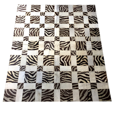 Hair on cowhide with zebra print area rug