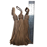 Set of three tan leather tassel with braided head
