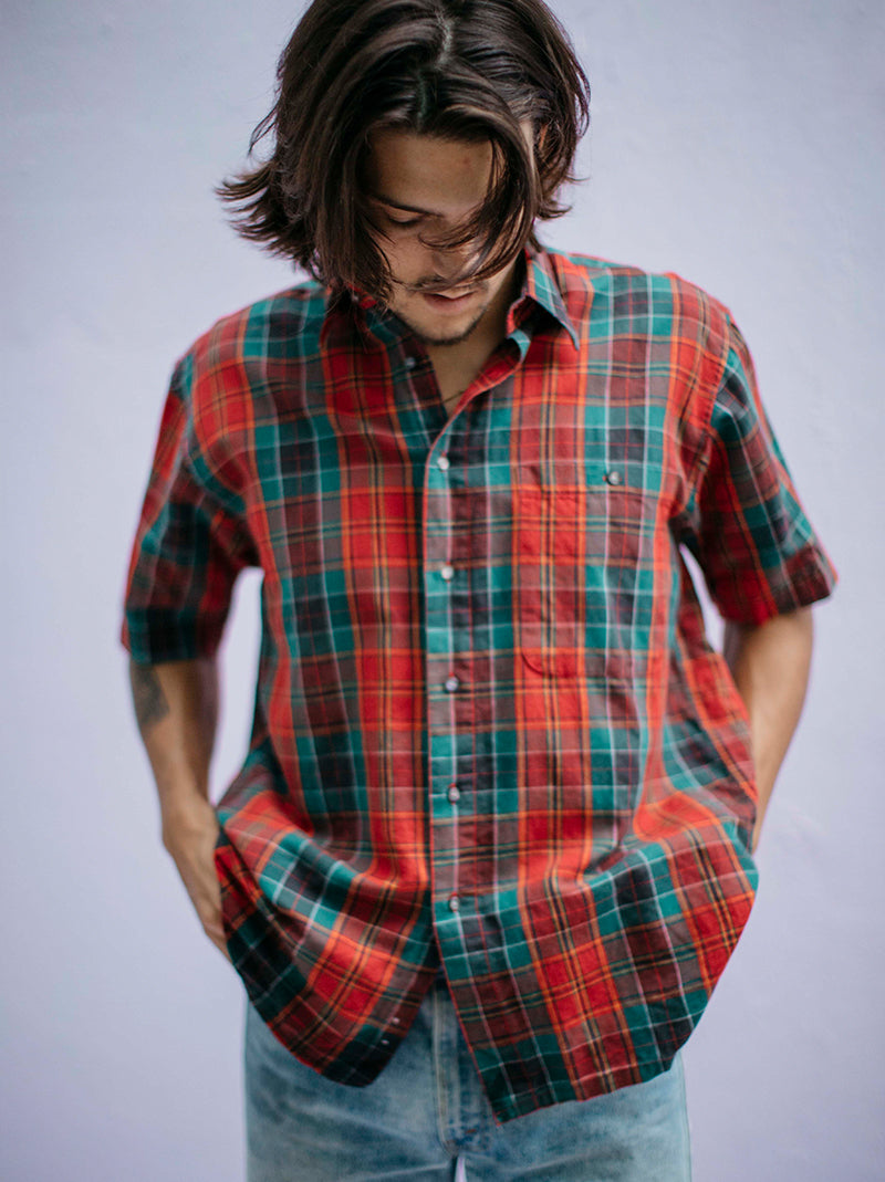 Fernando Peña red plaid shirt