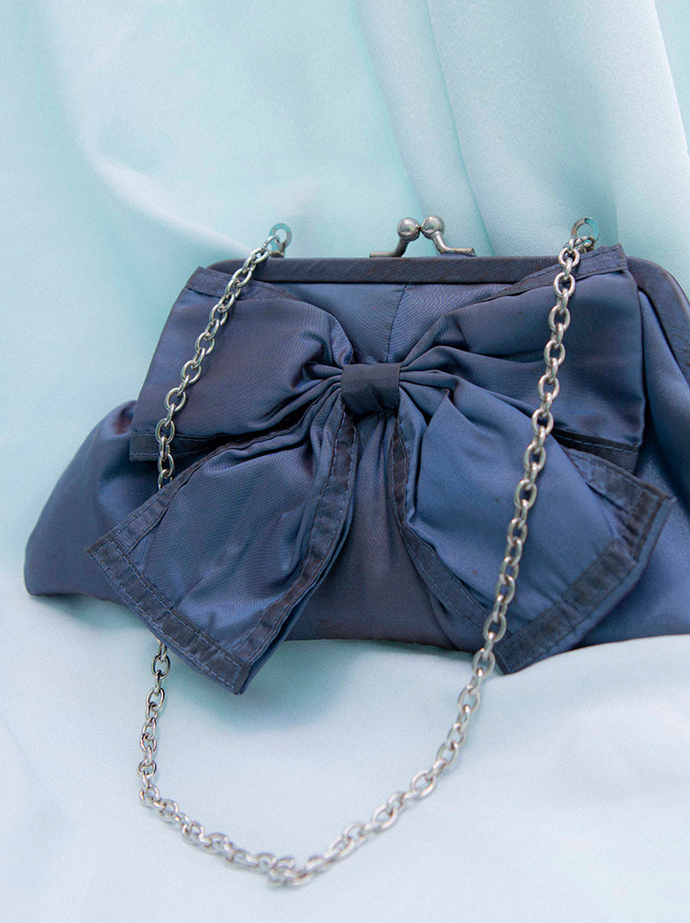 Cute 1970's vintage blue purse with bow