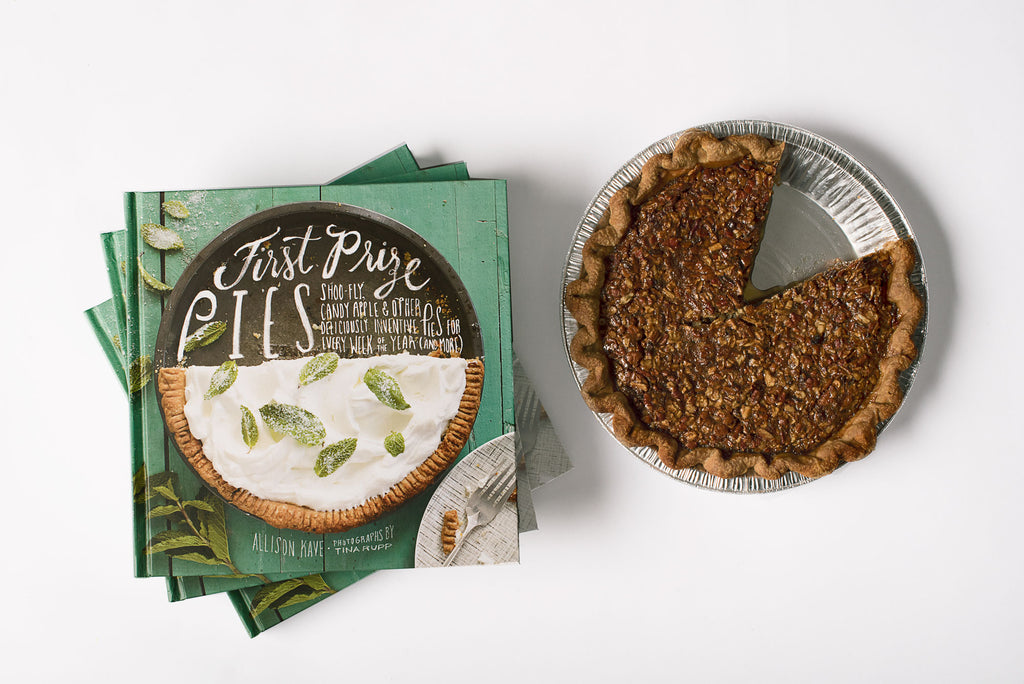 First Prize Pies Cookbook by Allison Kave next to a Bourbon Ginger Pecan Pie Cookbook