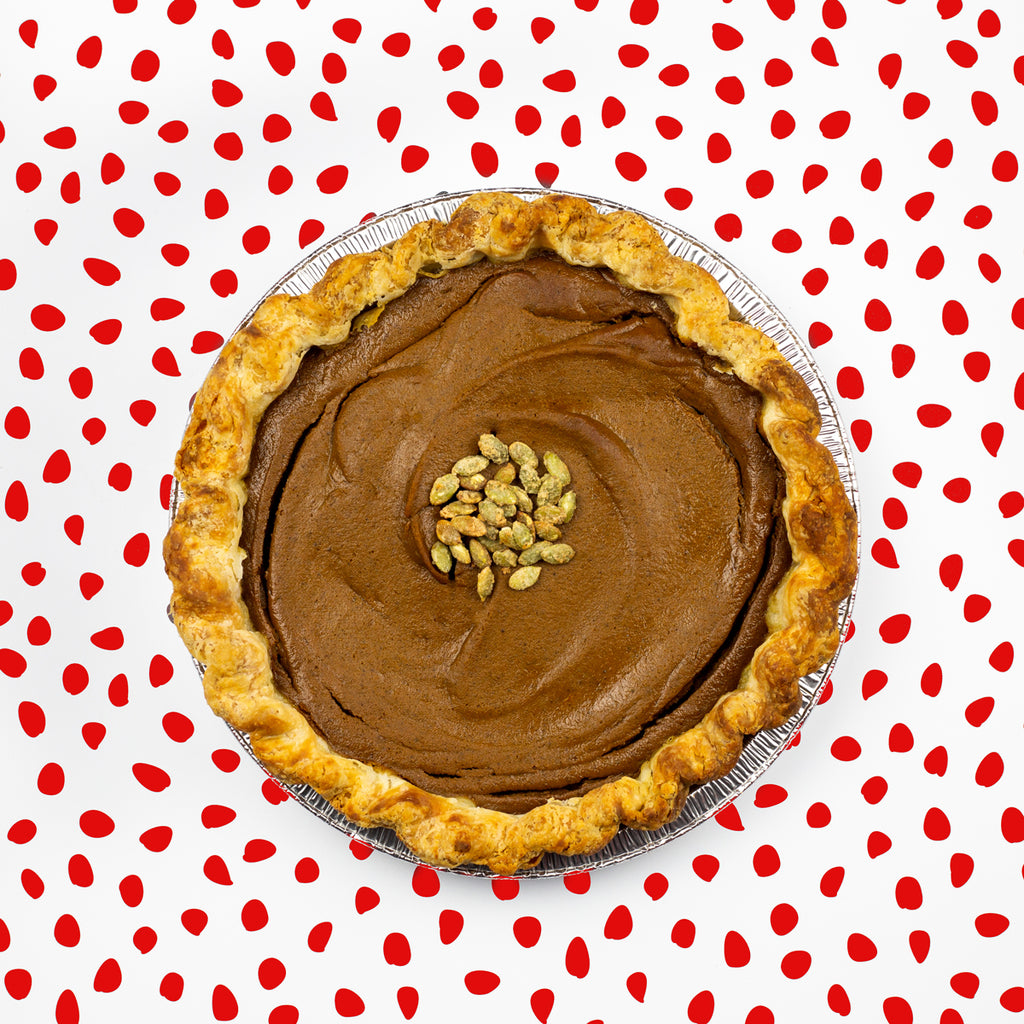 Pumpkin Spice Pie on red polka dot background