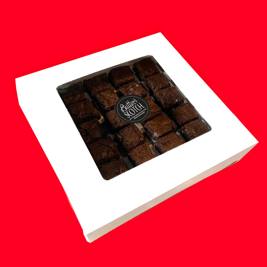 White window box of mini triple chocolate brownies with a black Butter & Scotch sticker on the box