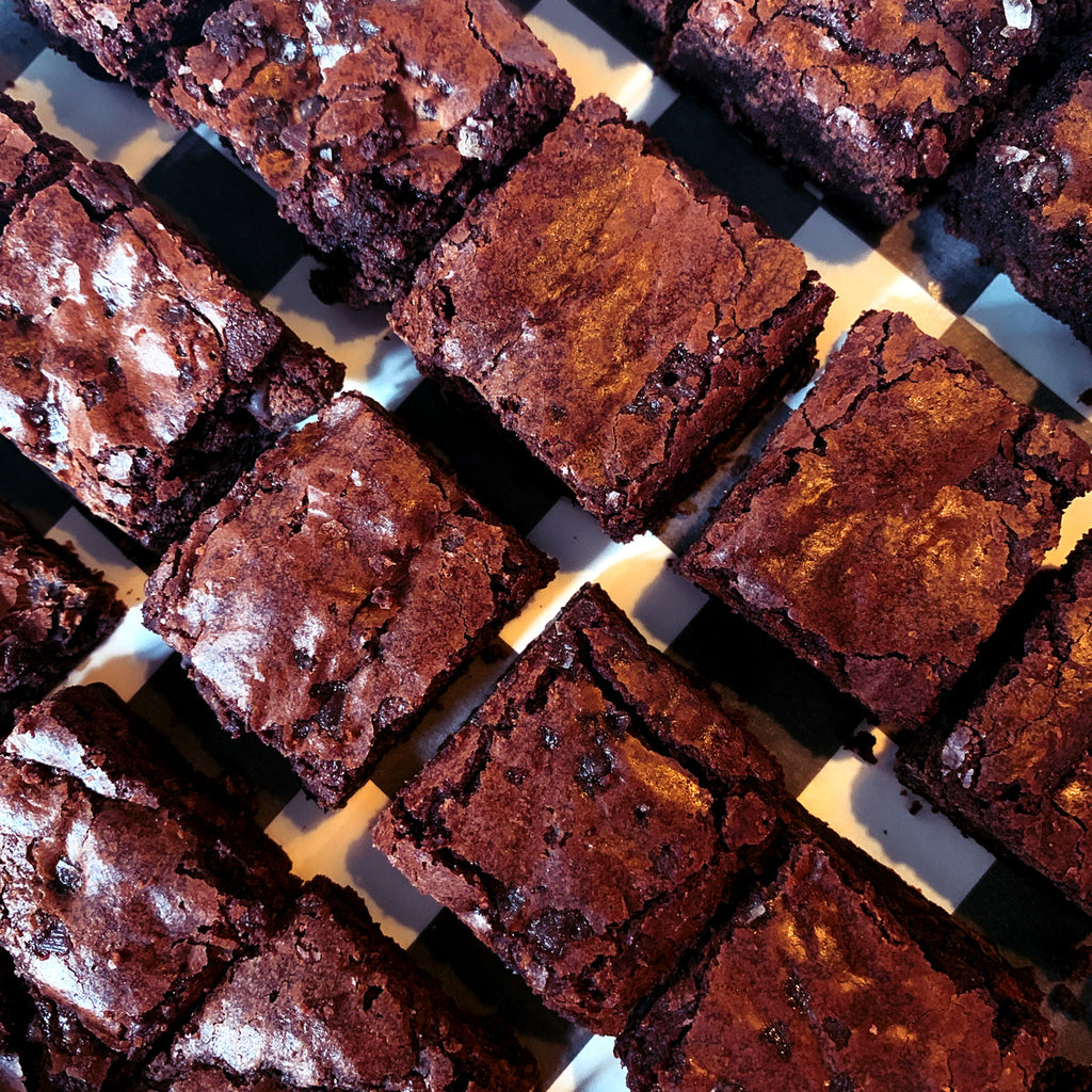close up of the Butter & Scotch mini triple chocolate brownies, dusted with sea salt