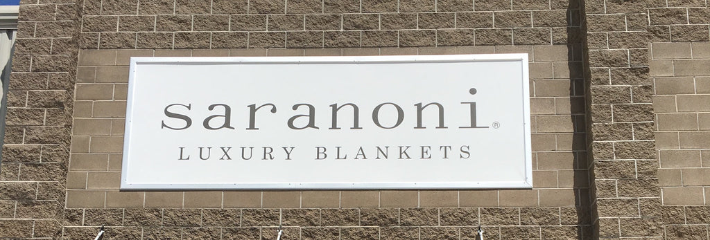 Store front signage for Saranoni Luxury Blankets located at 700 W 1700 S Suite 108 Logan, Utah 84321