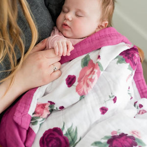 Peony Paradise baby girl blanket with pink and purple flowers making the perfect muslin fabric quilt.