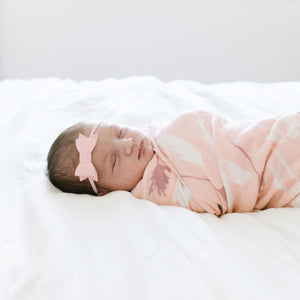 Newborn wrap swaddle blanket, white and pink flowers.