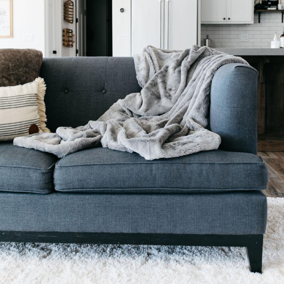 Gray faux fur throw blanket perfectly placed couch throw.