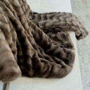 Brown throw blanket for the sofa.