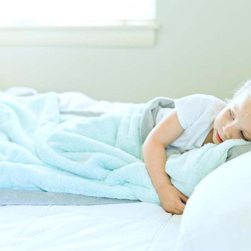 Little boy takes a nap with his warm and cozy min toddler blanket.
