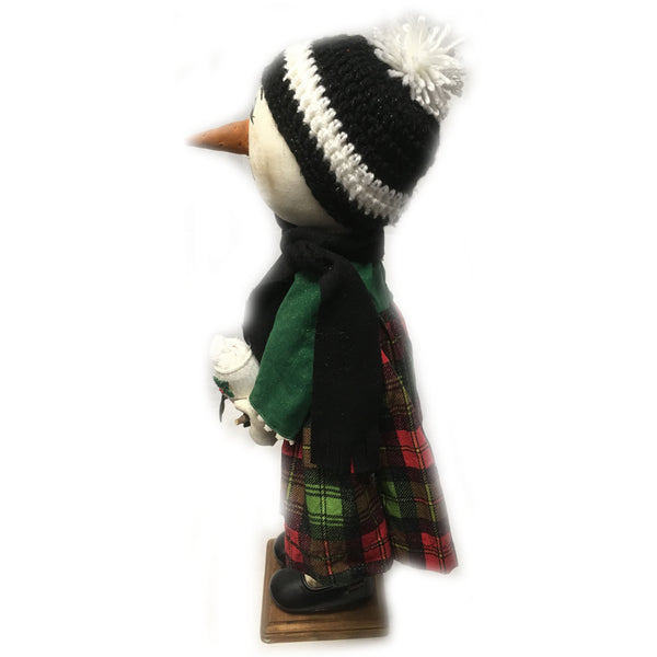 Standing Snow Girl in Christmas dress holding her little sock snowman