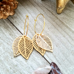 Beige and Gold Colored Metal Leaves Layered Earrings