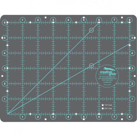 The Creative Grids Rotary Cutting Mat is double sided. One side features one-inch grids with eighth inch markings over the entire surface. All numbers are printed outside of the grid area so they are always visible. Popular 1-1/2 inch cuts are highlighted with white stars; 2-1/2 inch cuts with white squares. The other side is blank - perfect for trimming blocks and paper-piecing.