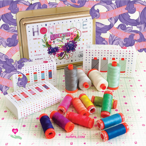 This LIMITED EDITION Aurifil Tula Pink HomeMade Collection comes in a collectable gold tin and includes 4 large spools and 10 small spools.  4 large spools 50wt: 5004, 6727, 2026, 2835 5 small spools 50wt: 2220, 5002, 2479, 2535, 2528 5 small spool 50wt: 5015,1231, 2860, 1320, 2730