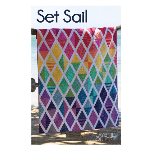 Prepare to Set Sail on a quilter's voyage. Create stunning diamonds with interest and movement that captivate and please the eye with this Fat Quarter Friendly Quilt!  This pattern is made with the Super Sidekick ruler, also by Jaybird Quilts.