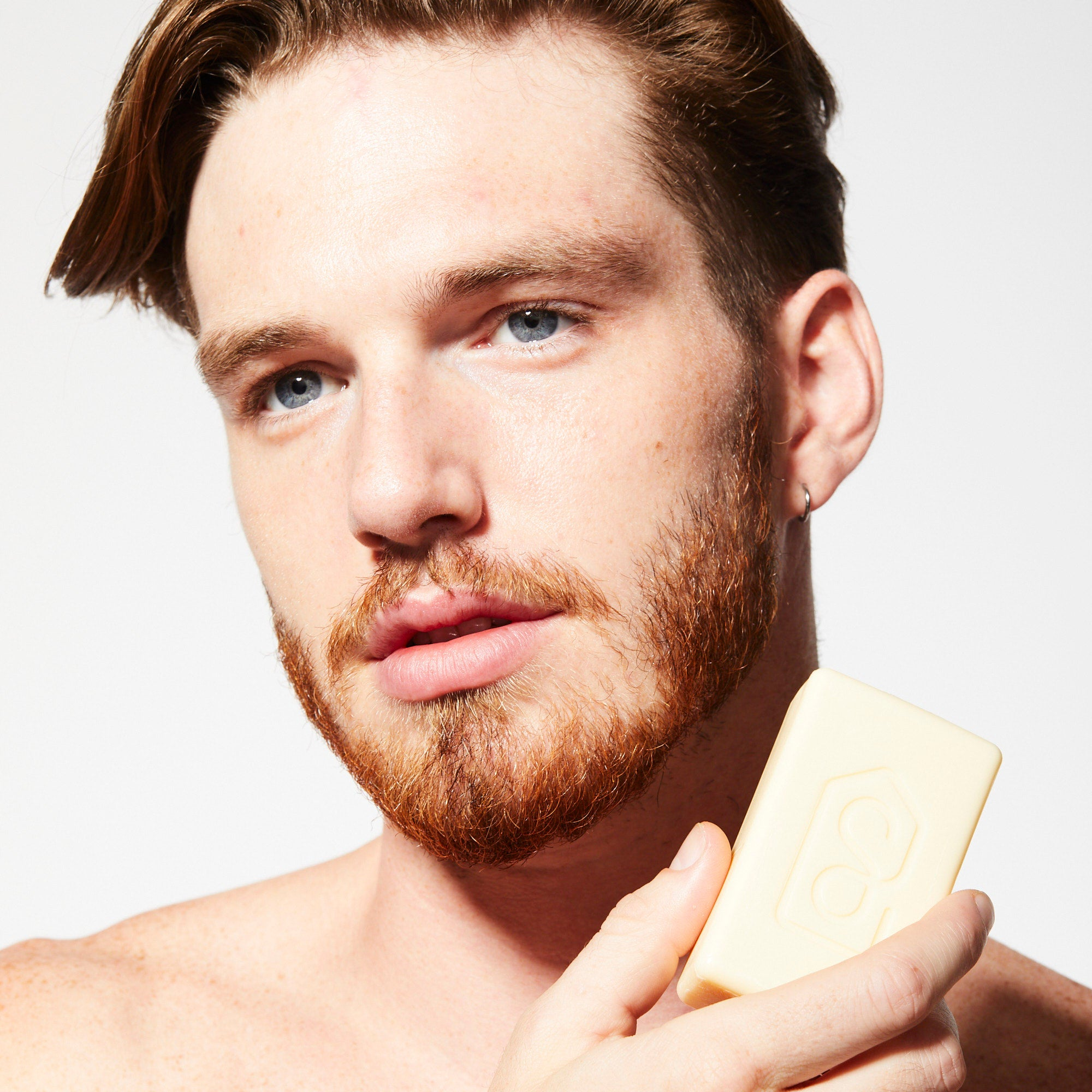 Bamboo Hydrate Bar Soap, man holding bar of soap near face
