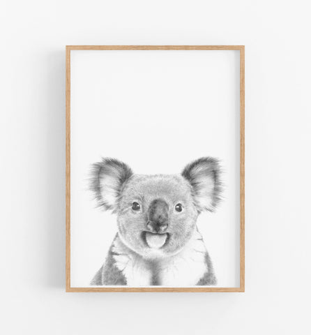 black and white animal art print in a teak frame
