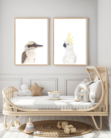 kookaburra and white cockatoo art prints hanging above a cane bed