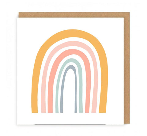 a greeting card with a rainbow on the front