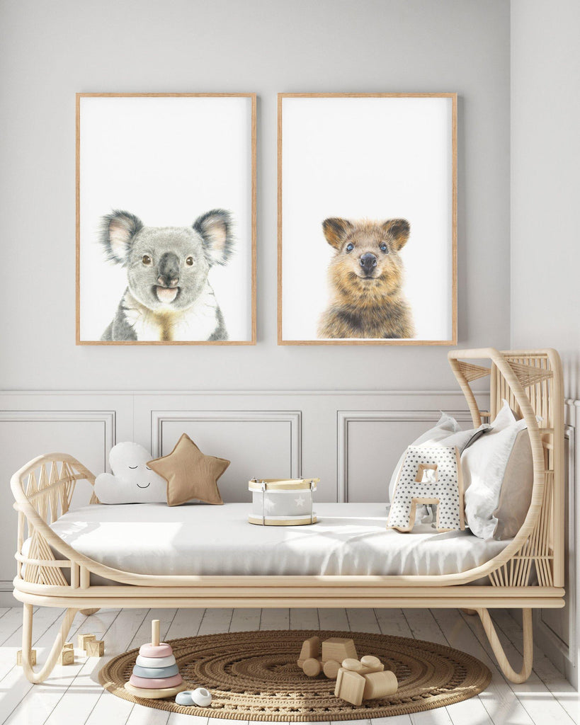 set of 2 Australian animal art prints hanging above a cane day bed