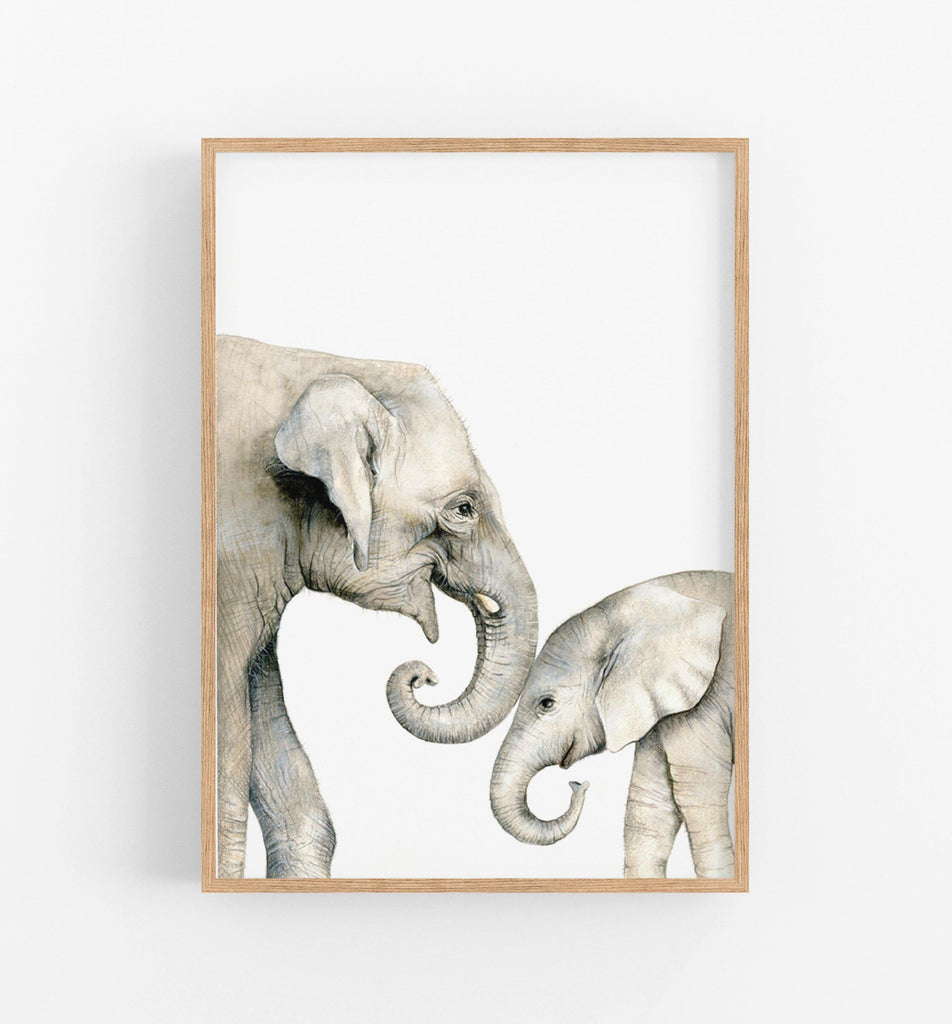 an art print in a teak frame of a mamma elephant and her baby
