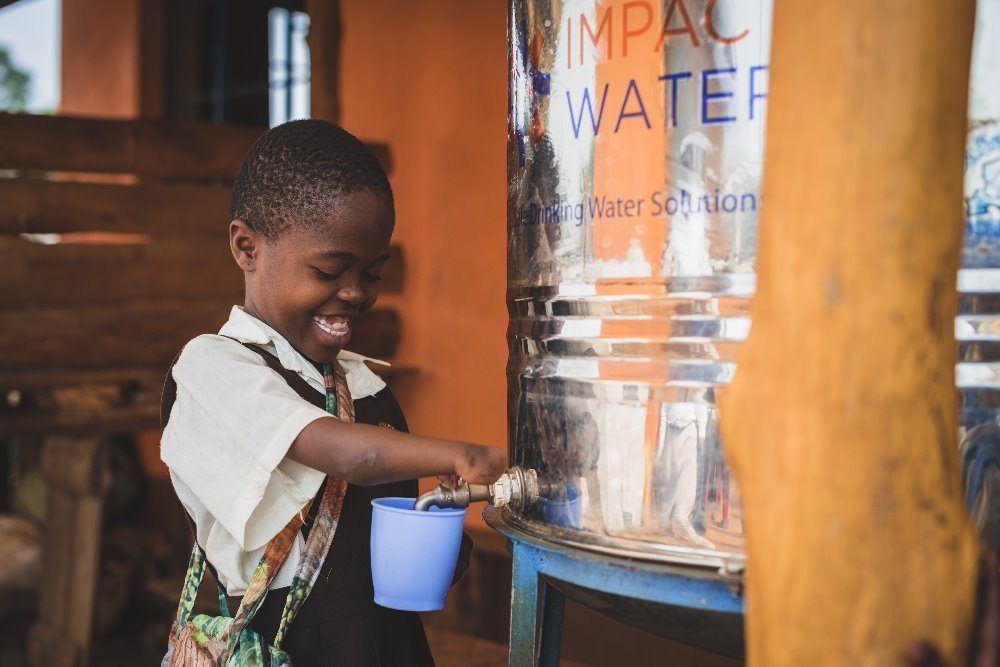Kenyan School Child with Impact Water
